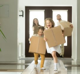 family caring moving boxes in a home