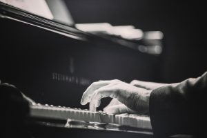 Image of a man playing a piano