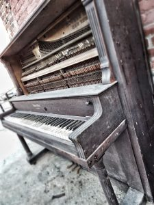 Piano being dismantled