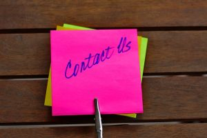 Words contact us on sticky notes