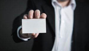 a blank business card in a hand
