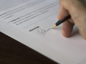 Signing Bill pf Lading papers for moving