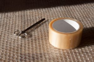 Bubble plastic and duck tape ready to pack antique furniture