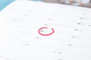 A calendar with a marked date