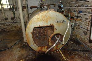 Rusty tank in wet basement