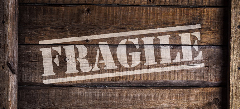 A box with the word 'fragile' written on it