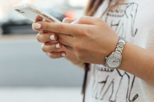 a woman holding a phone in her hands
