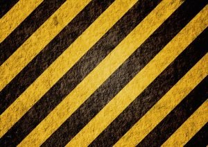 Yellow and black stripes to indicate danger of something you shouldn't store in a storage