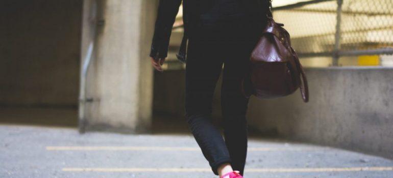 legs of a woman seen walking away