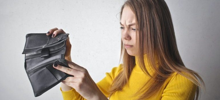 a woman with an empty wallet