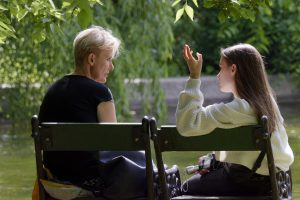Mother talking to her daughter before she organize a family move to Deerfield
