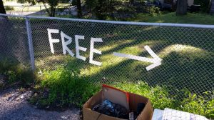 a sign showing wherre to get free moving boxes in Atkinson