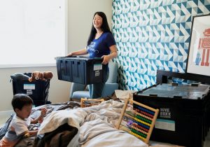 Person packing to reduce transportation expenses when moving.