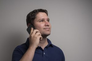 a man talking on the phone - Coping with anxiety after moving