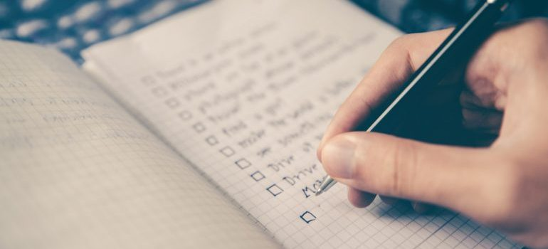 person going through a long-distance moving checklist