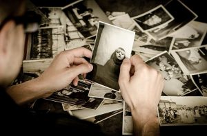 a person looking at old photos