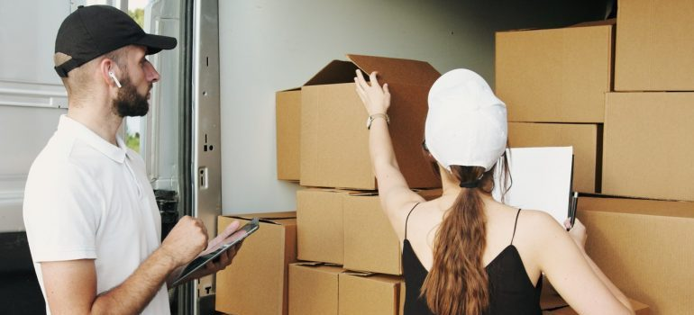 movers Goffstown NH packing a moving truck