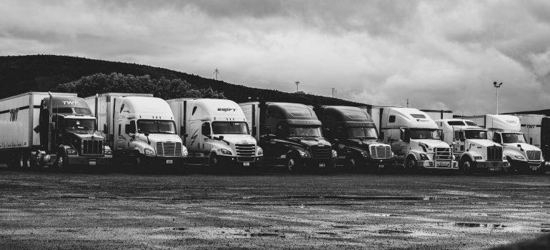 parked-trucks-under-clouds