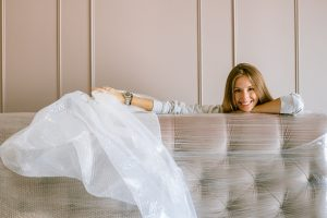 woman-smiling-behind-the-headboard
