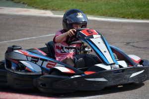 a child driving a go-kart