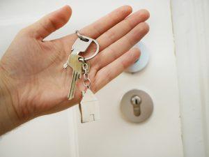 keys in hand next to the door