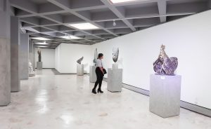 woman in a museum and statues