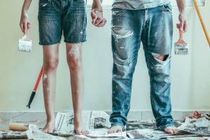 man and woman painting - upgrades that add value to your home