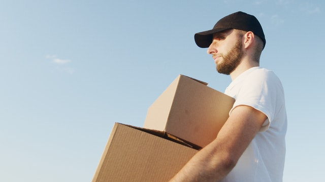 a man holding the boxes