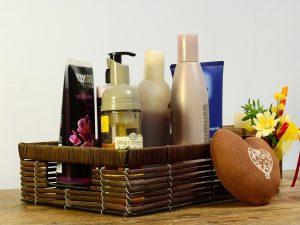 bathroom and cosmetic bottles in a basketa