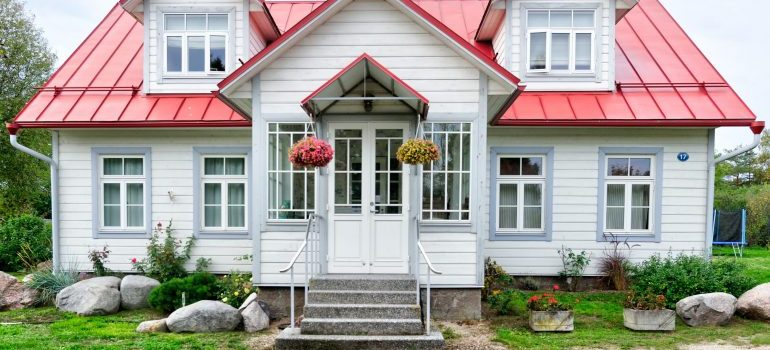 White home with a red roof