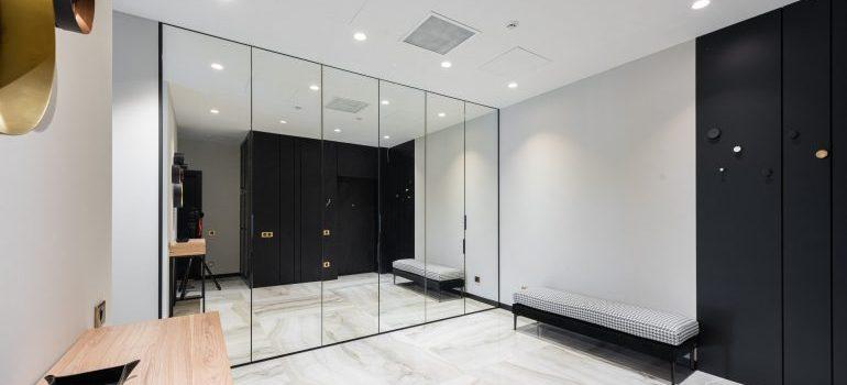 Mirror wardrobe in a room.