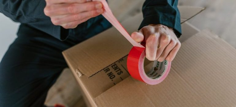 person packing a box