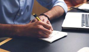 a man writing down