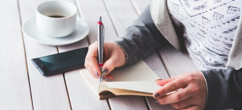 Woman writing in her notebook.
