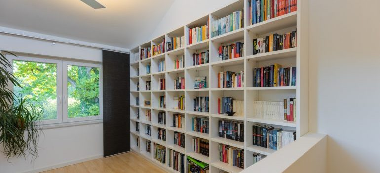 An organized shelve with books on it