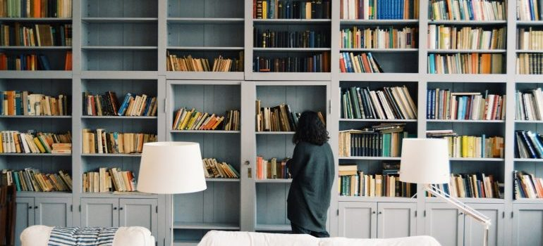 A woman searching for ways to pack and move a home library