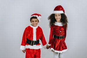 Kids wearing a Santa Claus costume
