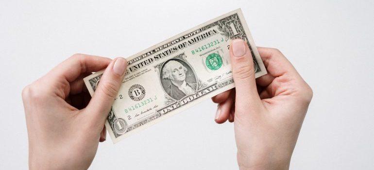 Person holding a dolar bill