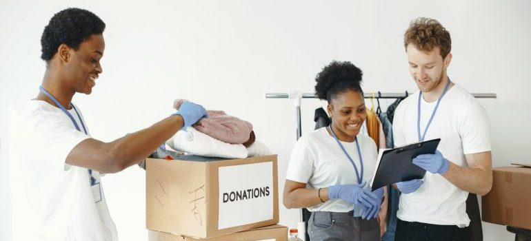 People packing up things for donating