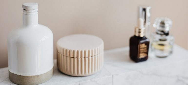 Cosmetics on a marble shelf