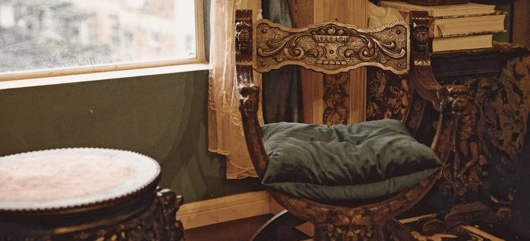 Antique chair next to a window