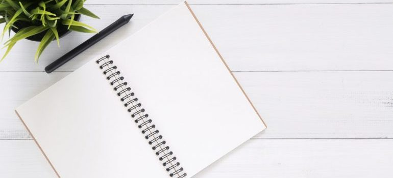 Blank pages in a planner ready for planning a budget friendly office moving