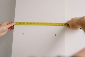 A man measuring walls